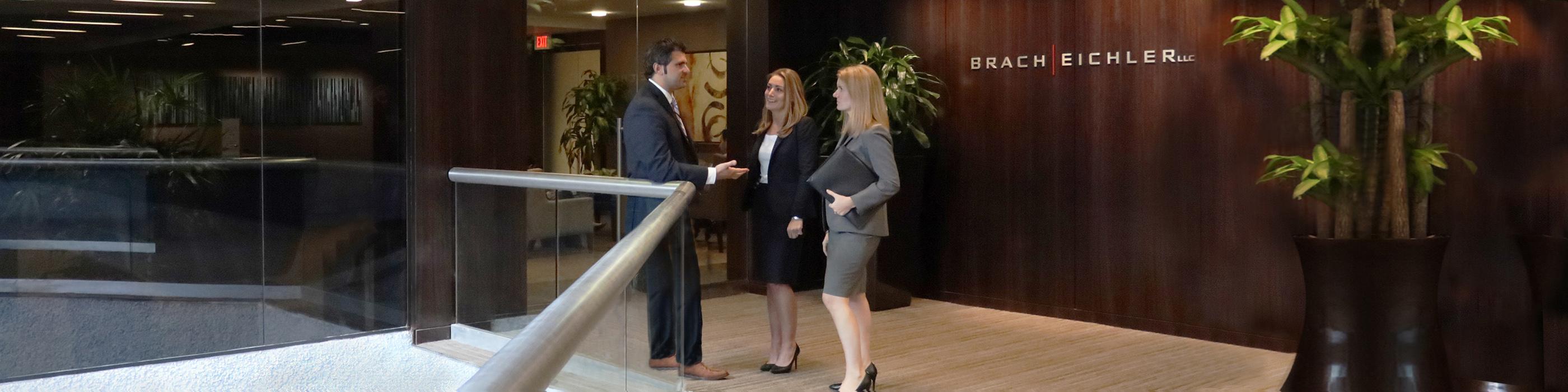 Three Brach Eichler Attorneys in entrance.